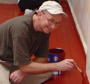 This is a bit more recent picture of me, from 2006. I'm painting the floor of an open-air atrium at Montana de Luz, an orphanage in Honduras for children with HIV/AIDS. I promise you'll learn more about MdL as you read this blog over time.