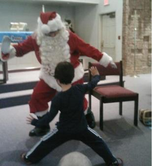 Santa bustin' some moves with a preschooler...